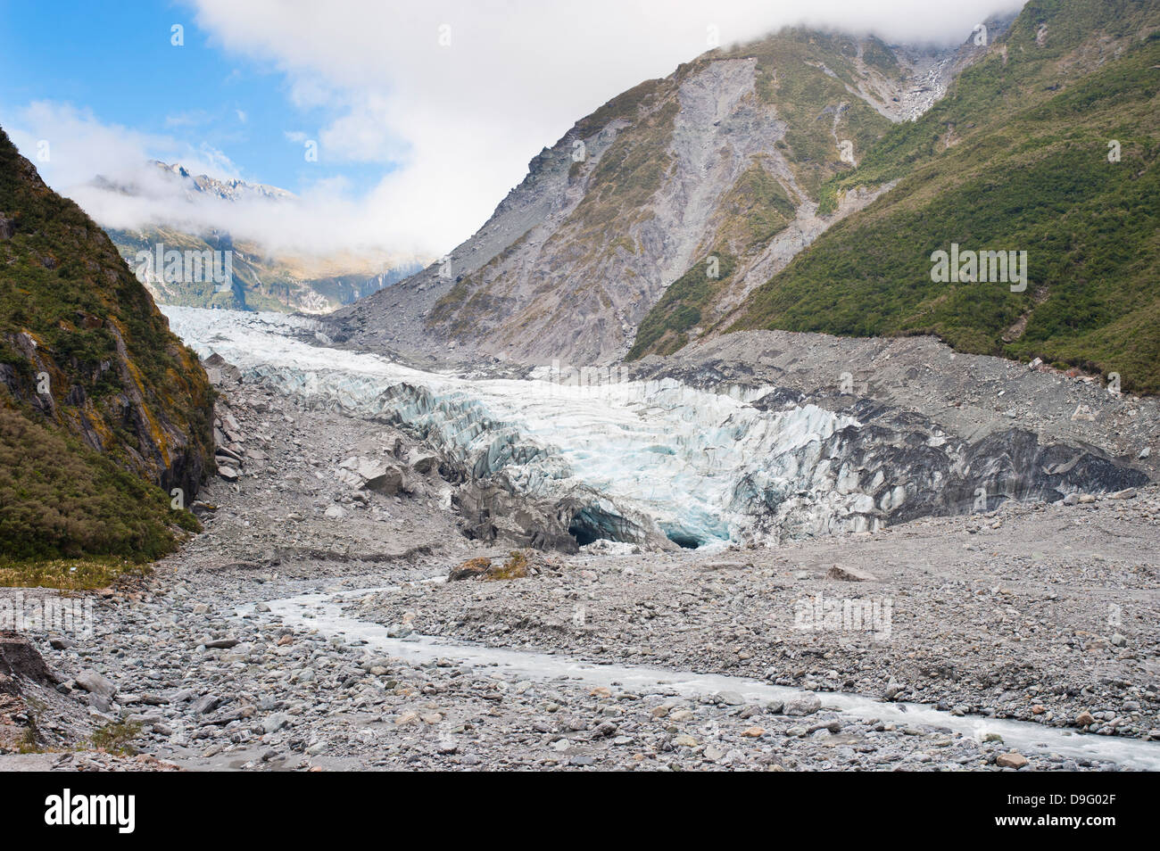 Glacier melt water river, Fox Glacier, Westland National Park, UNESCO World Heritage Site, South Island, New Zealand - Stock Image