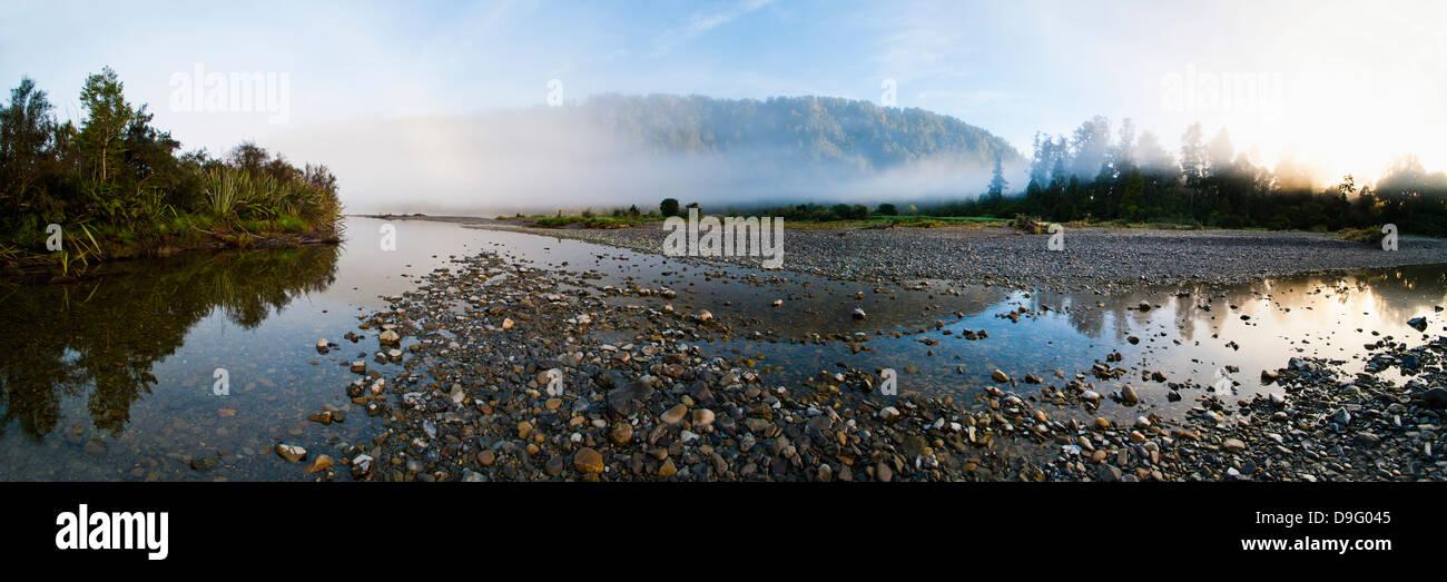 Waitangitanoa River at sunrise, Westland National Park, UNESCO World Heritage Site, West Coast of South Island, - Stock Image