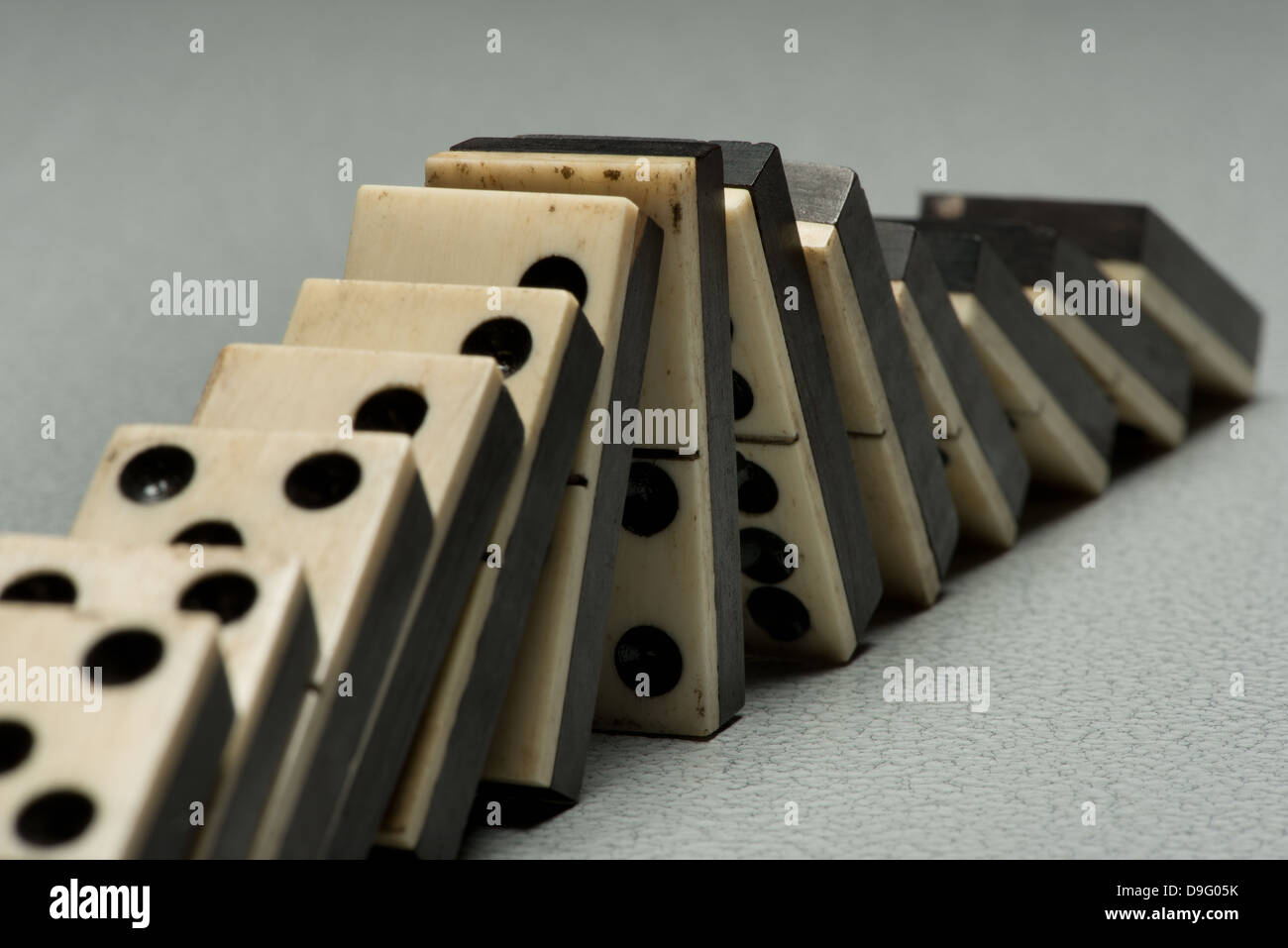 rows of lined up old ivory and ebony bronze pinned standing domino