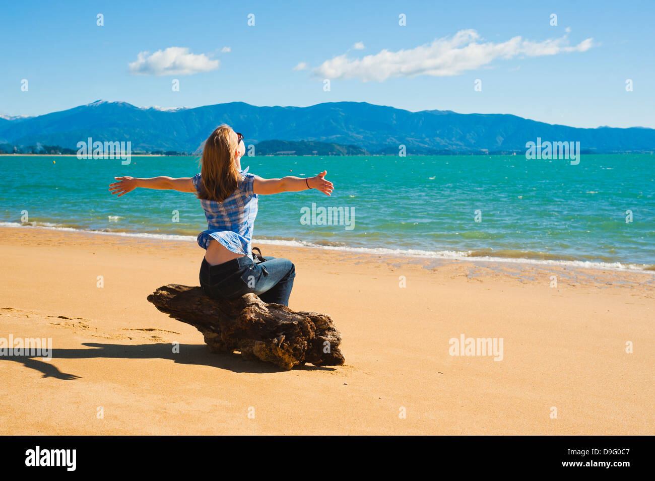 Woman on the beach at Tata Beach, Golden Bay, Tasman Region, South Island, New Zealand Stock Photo