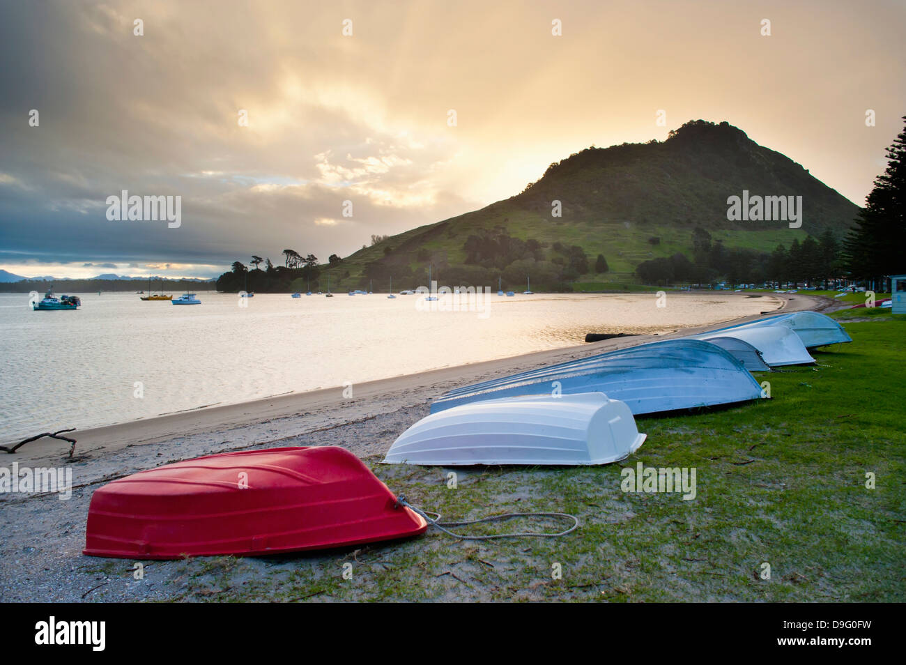 Boats at Mount Maunganui at sunset, Tauranga, North Island, New Zealand - Stock Image