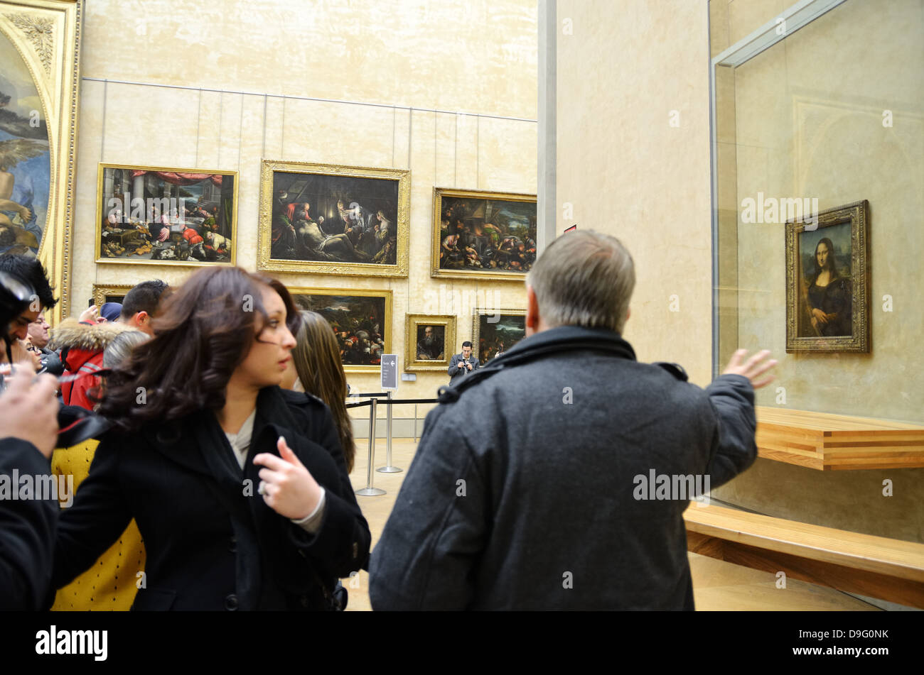 Visitors viewing the Mona Lisa in the Musee du Louvre in Paris, France - Jan 2012 Stock Photo