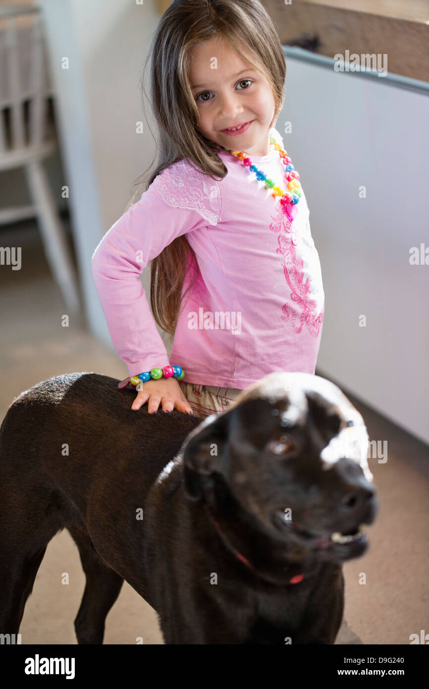 Portrait of a girl with her dog at home - Stock Image