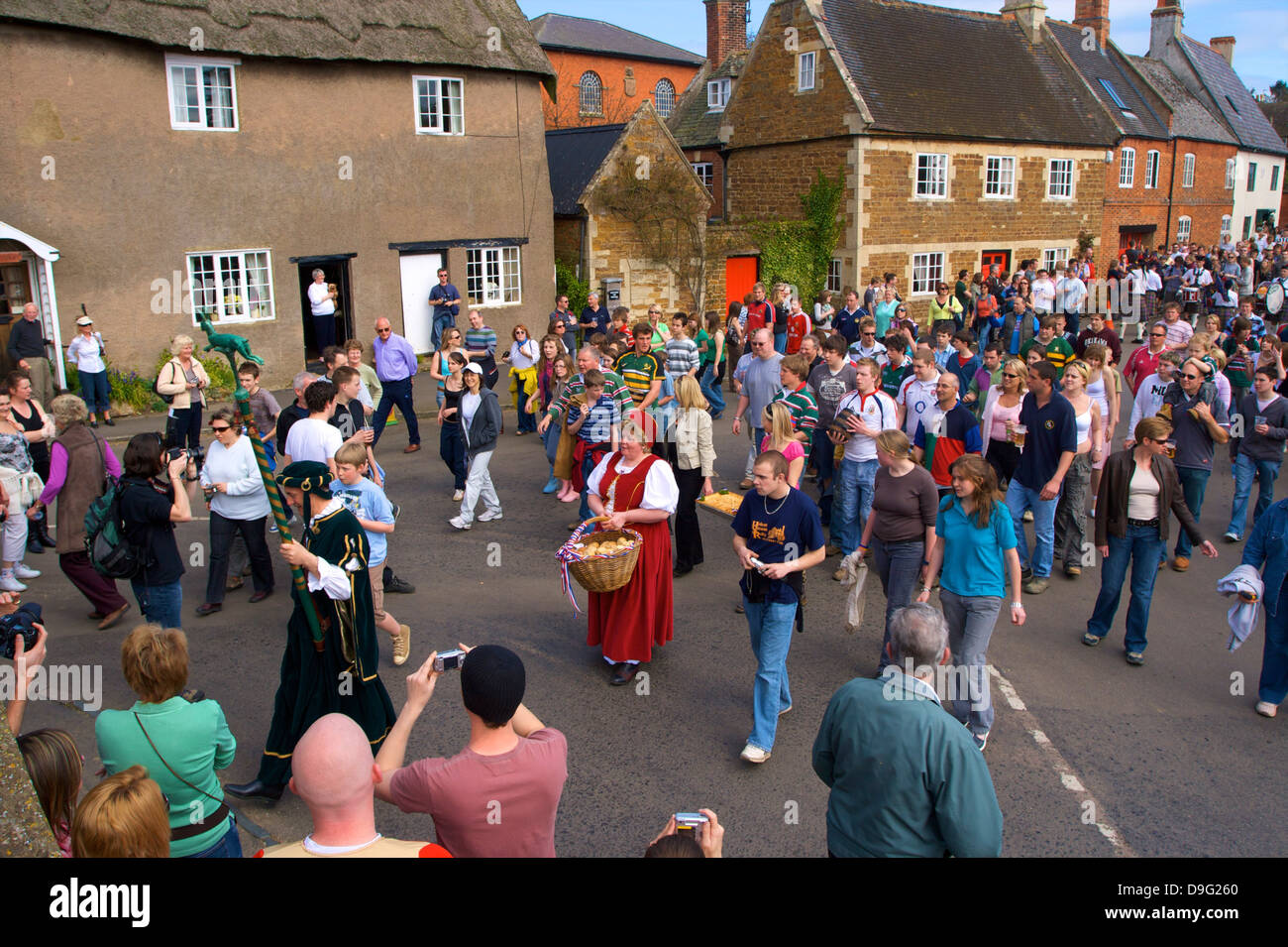 Leaders and participants of the Procession for the Old Annual Custom of Bottle-kicking, Hallaton, Leicestershire, - Stock Image