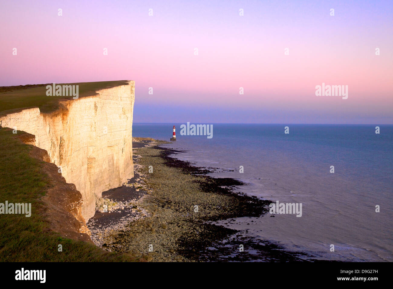Beachy Head and Beachy Head Lighthouse at sunset, East Sussex, England, UK - Stock Image