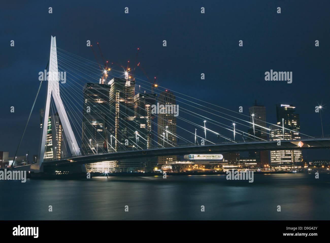 Erasmusbrug (Erasmus Bridge) crossing the Nieuwe Maas River, at night, Rotterdam, South Holland, The Netherlands Stock Photo