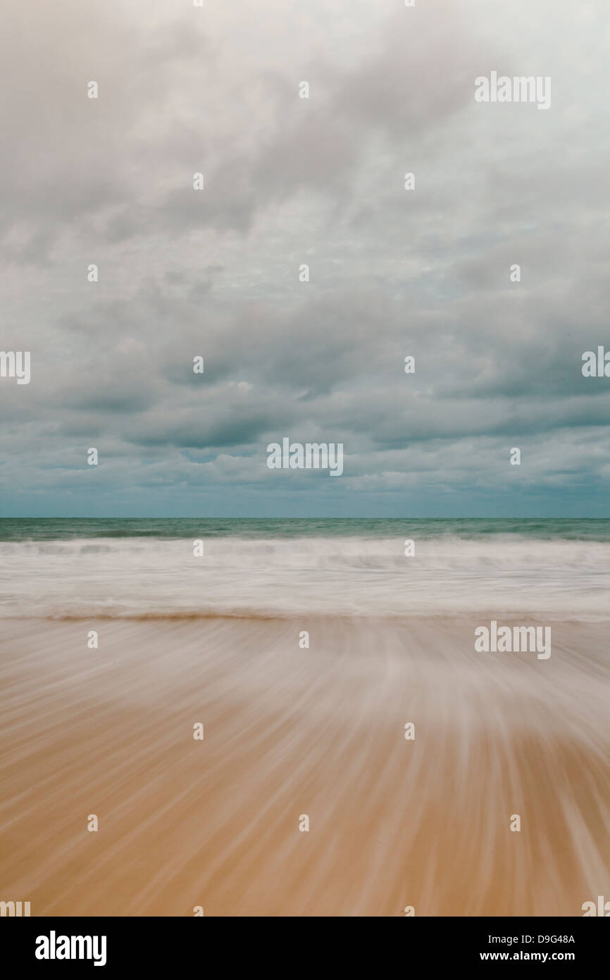 Tidal motion on Carbis Bay beach, St. Ives, Cornwall, England, UK - Stock Image