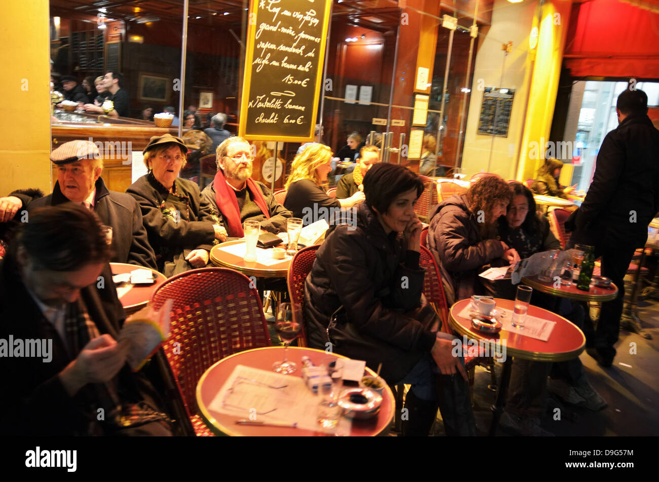 People at street cafe in Paris, France - Jan 2012 Stock Photo