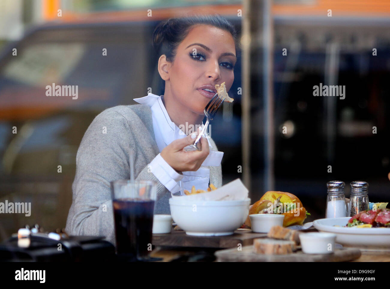 42f2d35cb4 Kim Kardashian having lunch with a friend at Breadbar in West Hollywood  during filming for her reality show  Keeping Up with the Kardashians  Los  Angeles