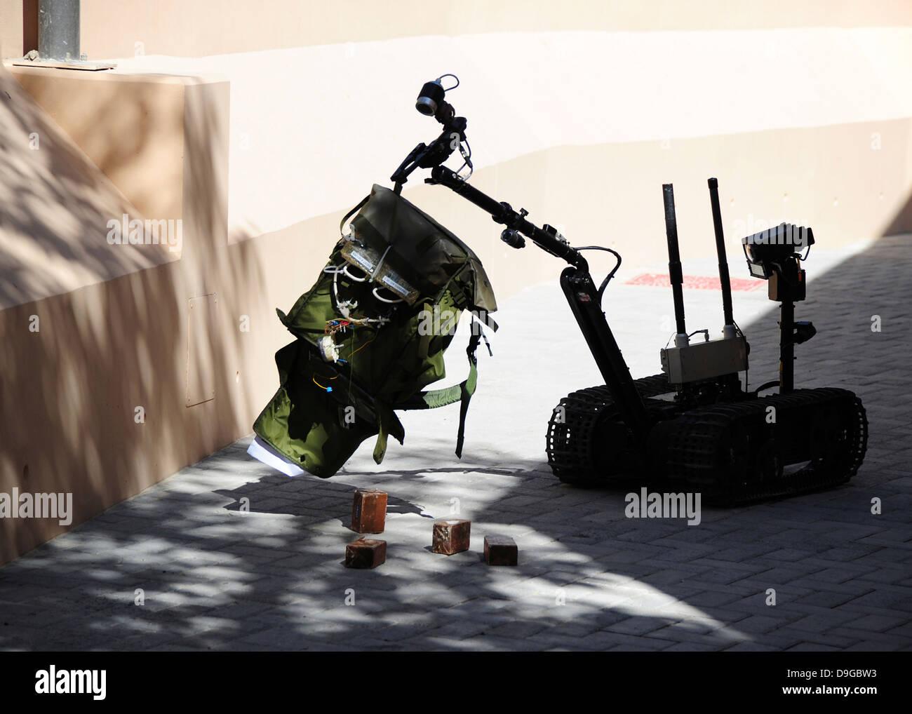 Talon remote-controlled robot investigates an improvised explosive device. - Stock Image