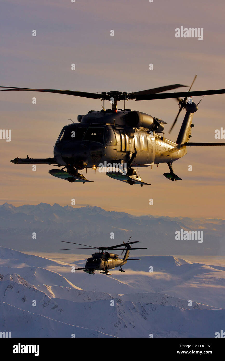 Two Alaska Air National Guard HH-60G Pave Hawks in flight over Alaska - Stock Image