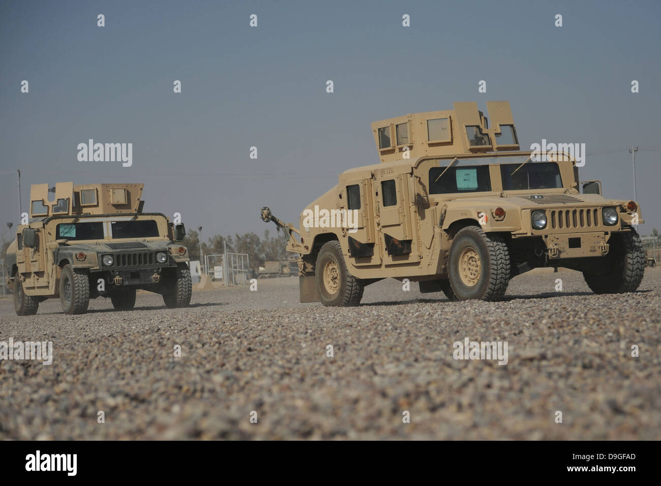 Two M1114 Humvee vehicles at Camp Taji, Iraq. - Stock Image