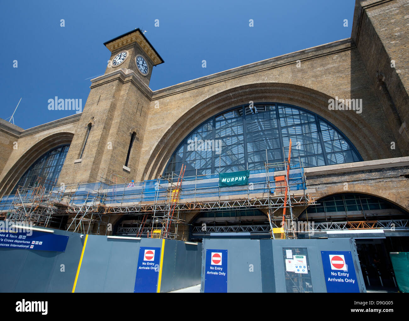Construction work to restore original facade of Kings Cross Station, London - Stock Image
