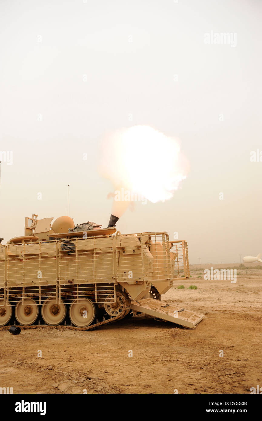 A M120 Mortar system is fired out of a M113 Armored Personal Carrier. - Stock Image