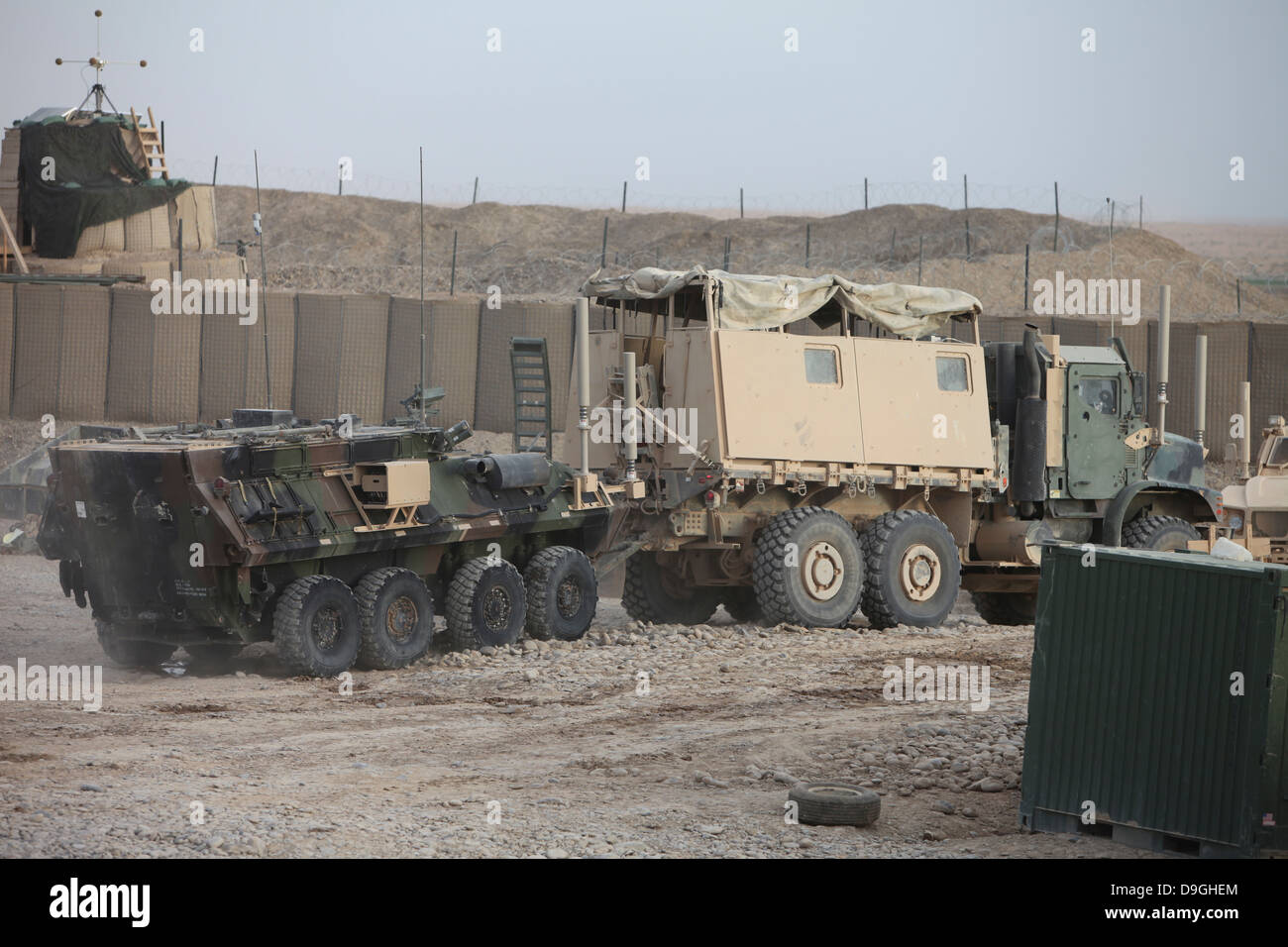 Marines with Combat Logistics Battalion 5, tow a light armored vehicle at Forward Operating Base Payne, Afghanistan, - Stock Image