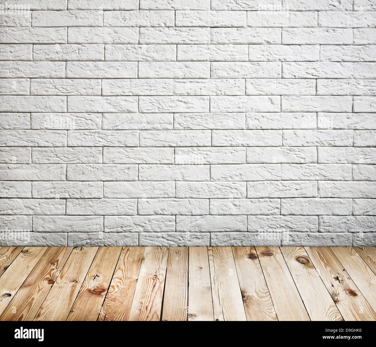 room interior with white brick wall and wood floor background stock