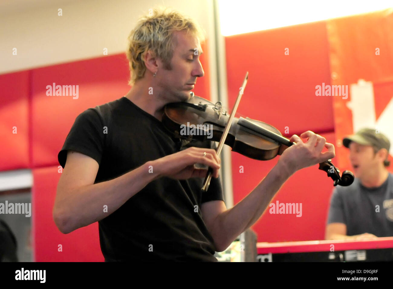 Jonathan Sevink (fiddle)  for The Levellers  The Levellers recording live performance of the record 'Levelling - Stock Image