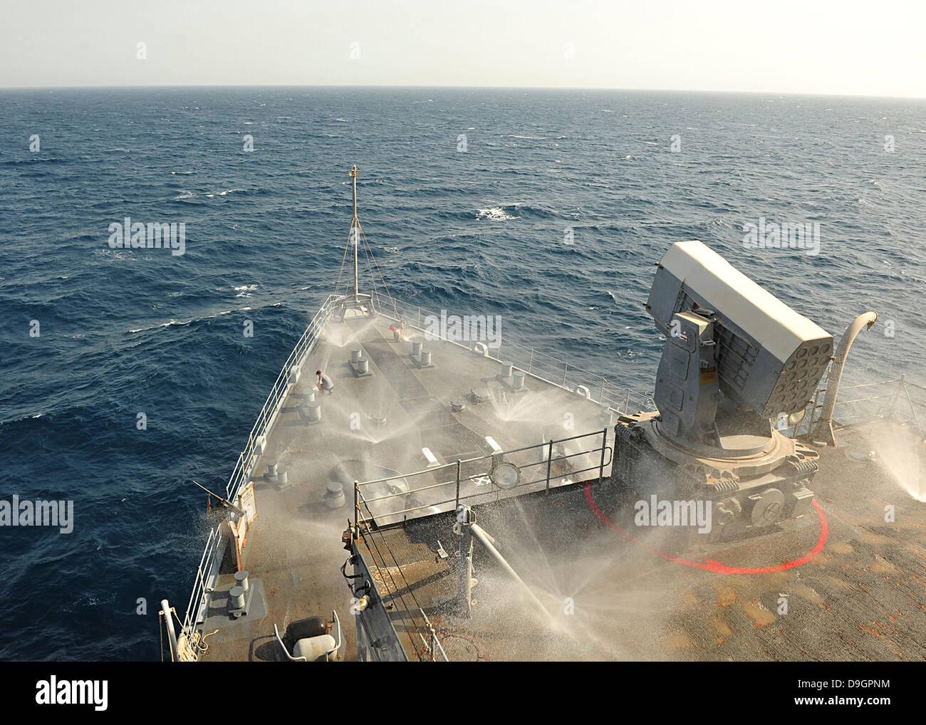 The countermeasure wash down sprinkler system aboard USS Gunston Hall. - Stock Image