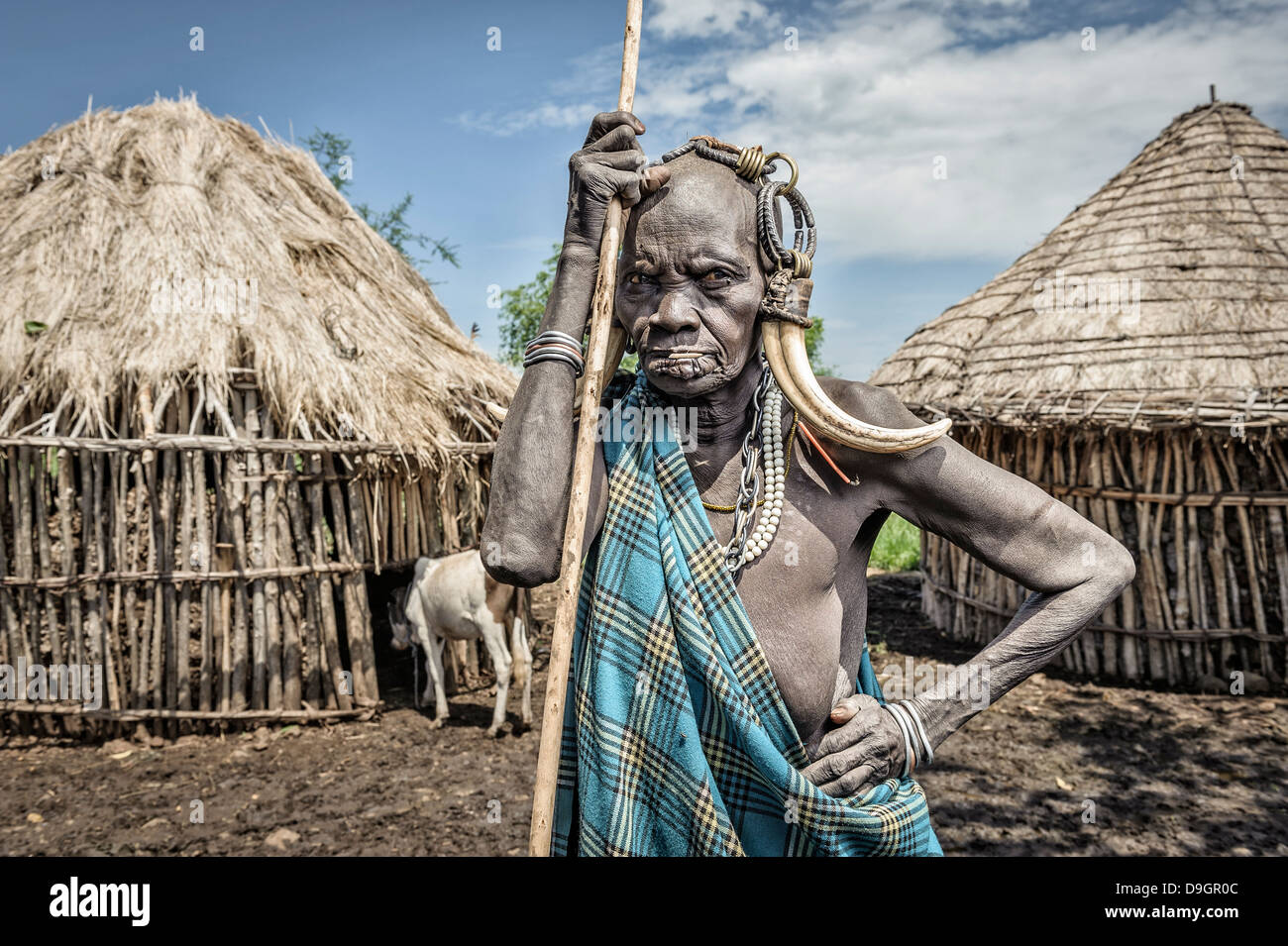 Portrait of an old Mursi woman with typical ornaments, Omo valley, Ethiopia - Stock Image