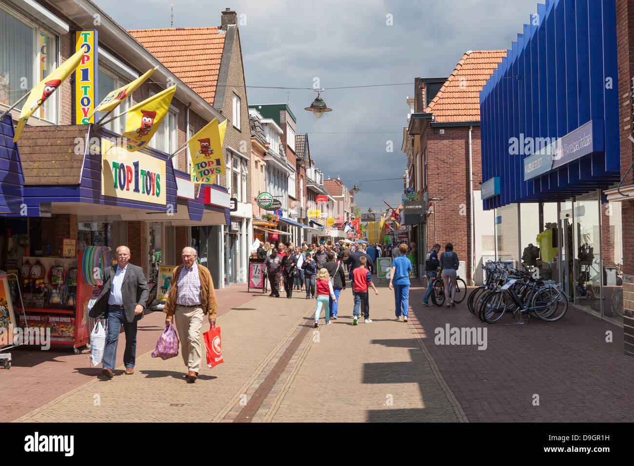 People shopping in the center of the city Winterswijk in the Netherlands - Stock Image