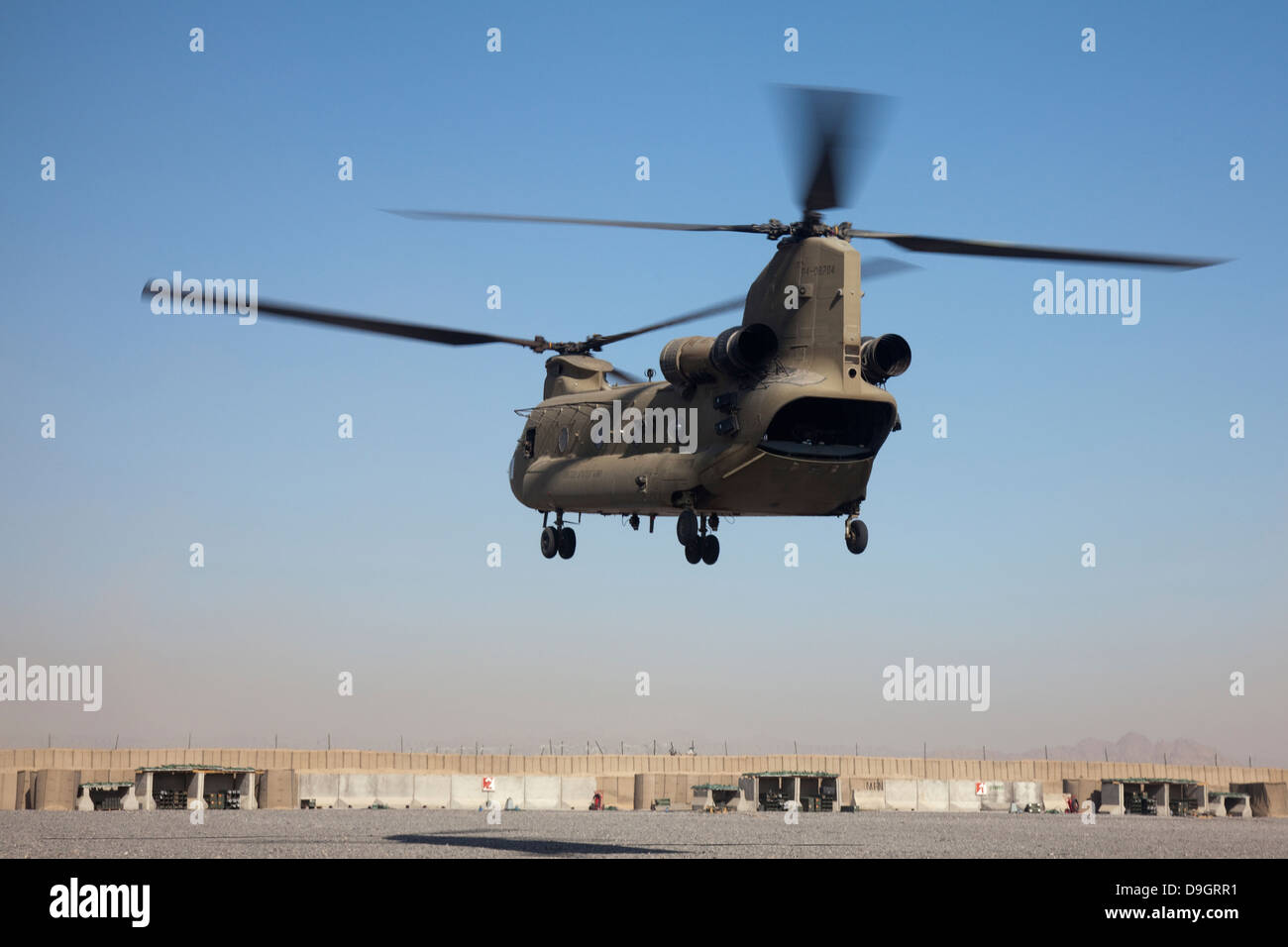 A CH-47 Chinook helicopter prepare to land. - Stock Image