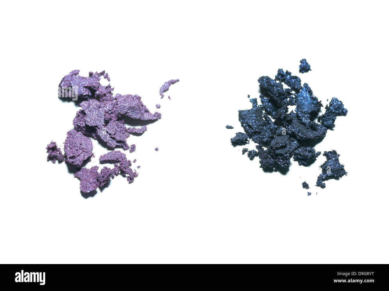 loose purple eyeshadow powder cut out onto a white background - Stock Image