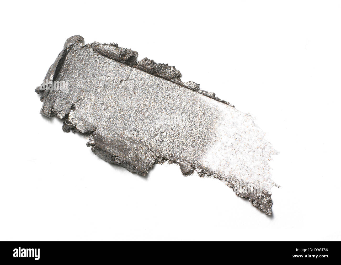 grey green eyeshadow smear cut out onto a white background - Stock Image