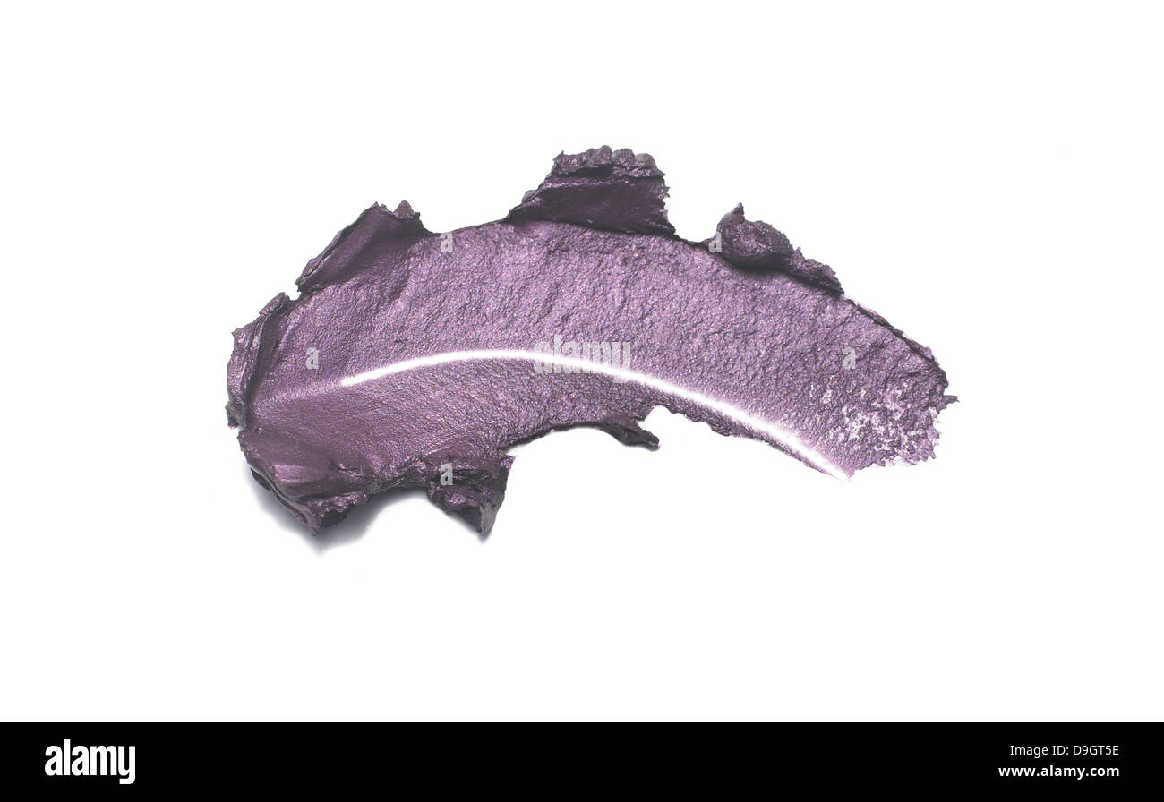 purple cream eyeshadow smear cut out onto a white background - Stock Image