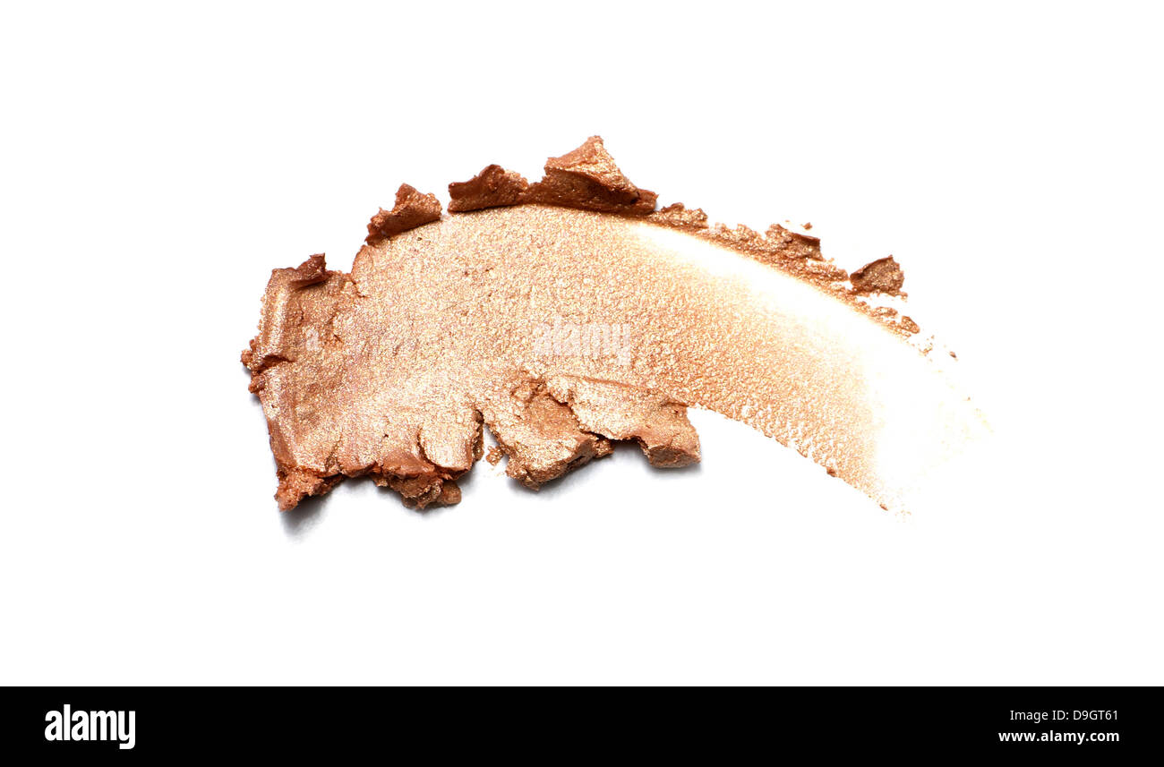 gold cream shimmer eyeshadow cut out onto a white background - Stock Image