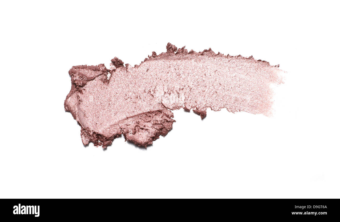 pink shimmer eyeshadow smear cut out onto a white background - Stock Image