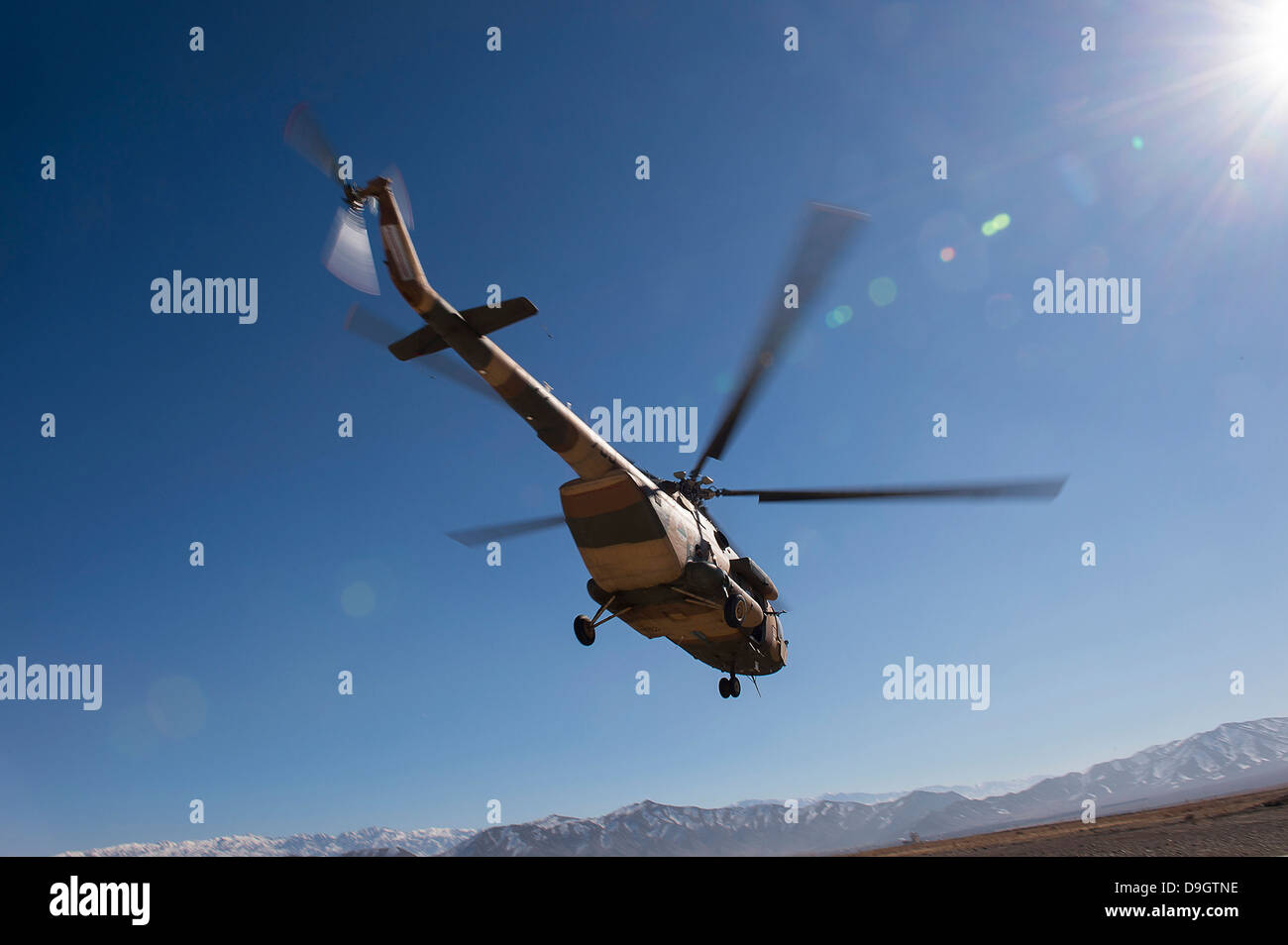 An Afghan Air Force Mil Mi-17 helicopter over Afghanistan. Stock Photo