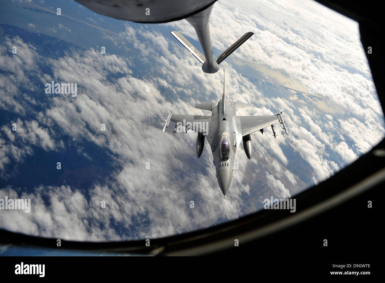 An F-16 Fighting Falcon prepares for aerial refueling. - Stock Image