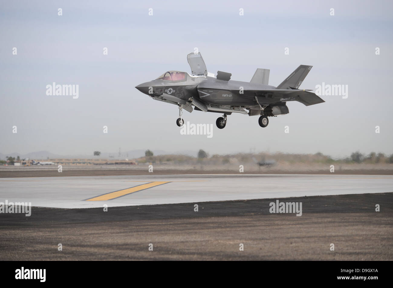 An F-35B Lightning II Joint Strike Fighter prepares to make a vertical landing. - Stock Image