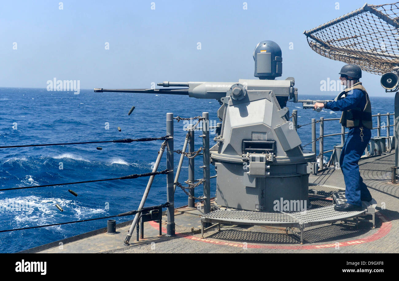 USS Monterey conducts a live-fire exercise. Stock Photo