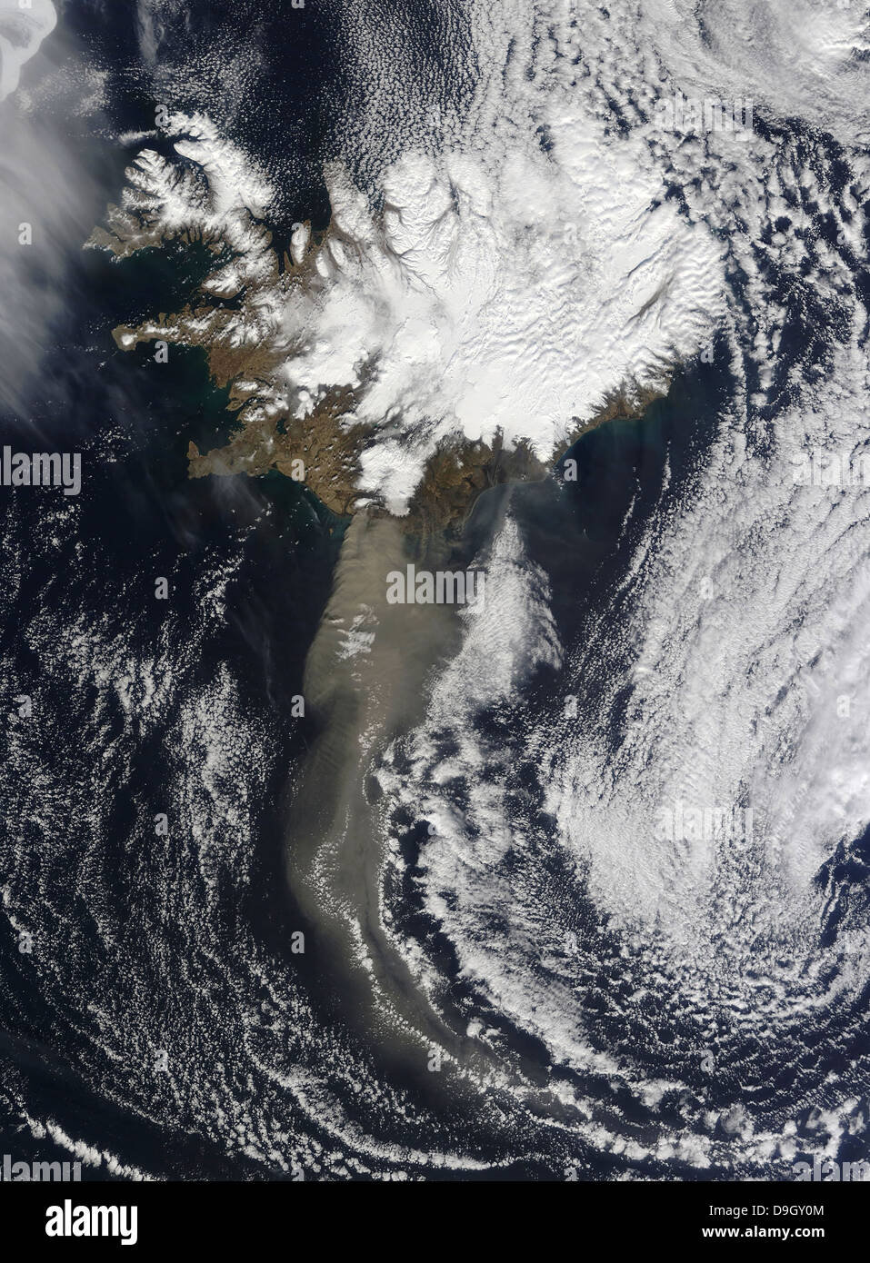 A cloud of ash from Iceland's Eyjafjallajokull volcano extends over the ocean. - Stock Image