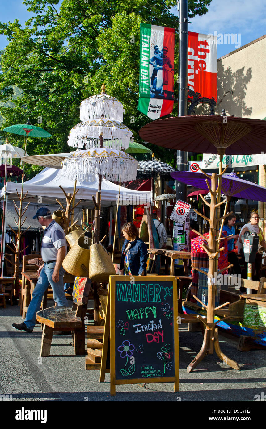People wander through colourful displays of home decor on display on Italian Day 2013, a street festival in Vancouver - Stock Image