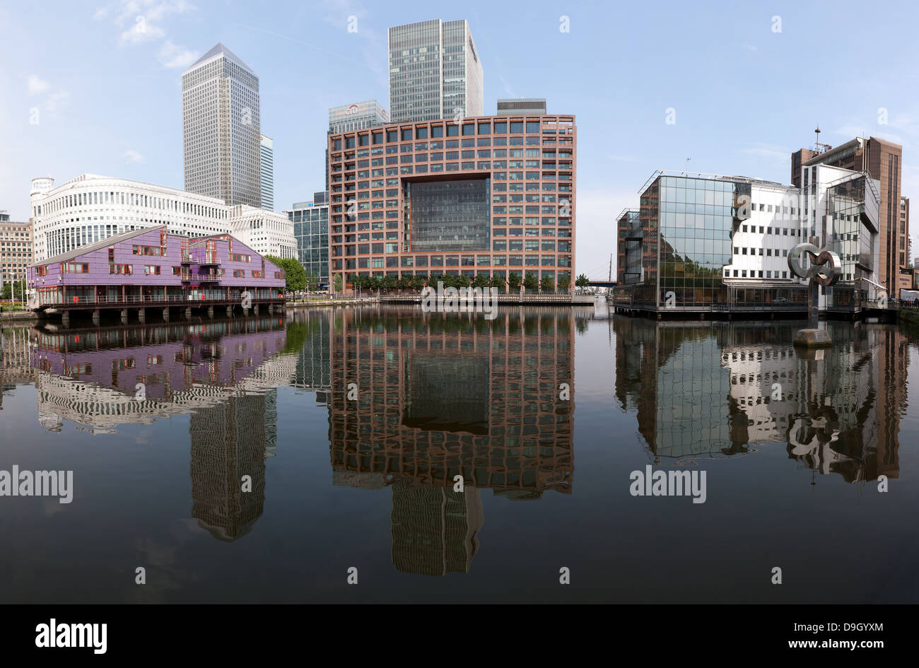 Large, wide-angle, panoramic, photostiched image looking across the South Dock towards the Canary Wharf estate. Stock Photo