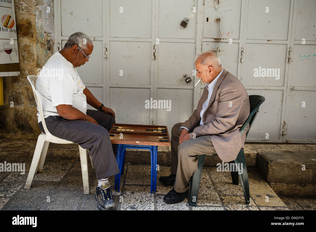 arab men playing backgammon at the old city, Jerusalem, Israel. - Stock Image