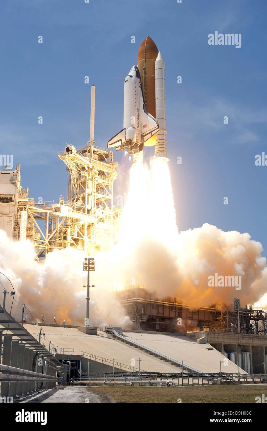 Space shuttle Atlantis' twin solid rocket boosters propel to launch the spacecraft off Kennedy Space Center's - Stock Image