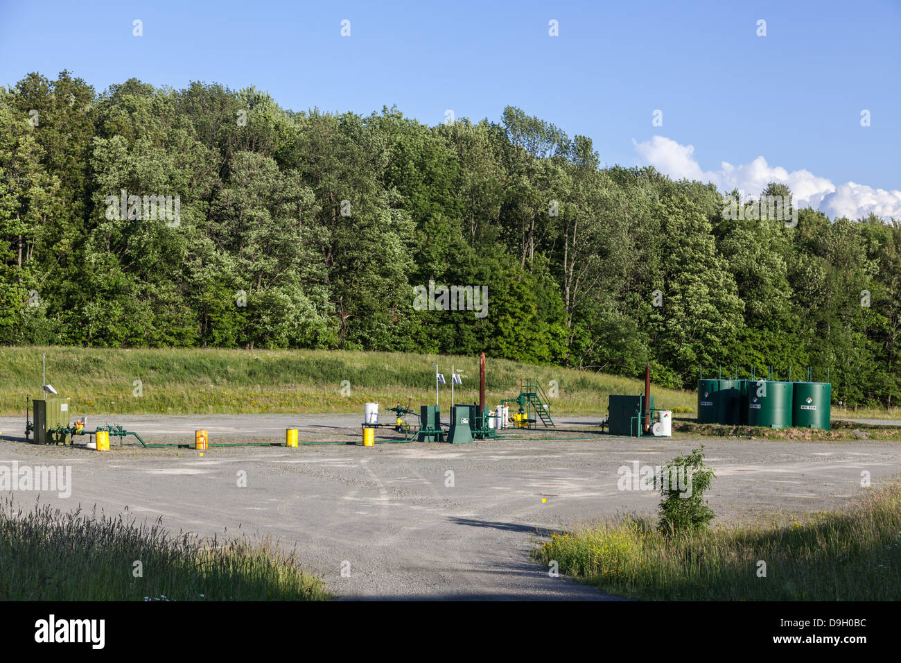 Dimock, Pennsylvania: a fracking site after drilling is completed includes tanks to hold brine water. - Stock Image