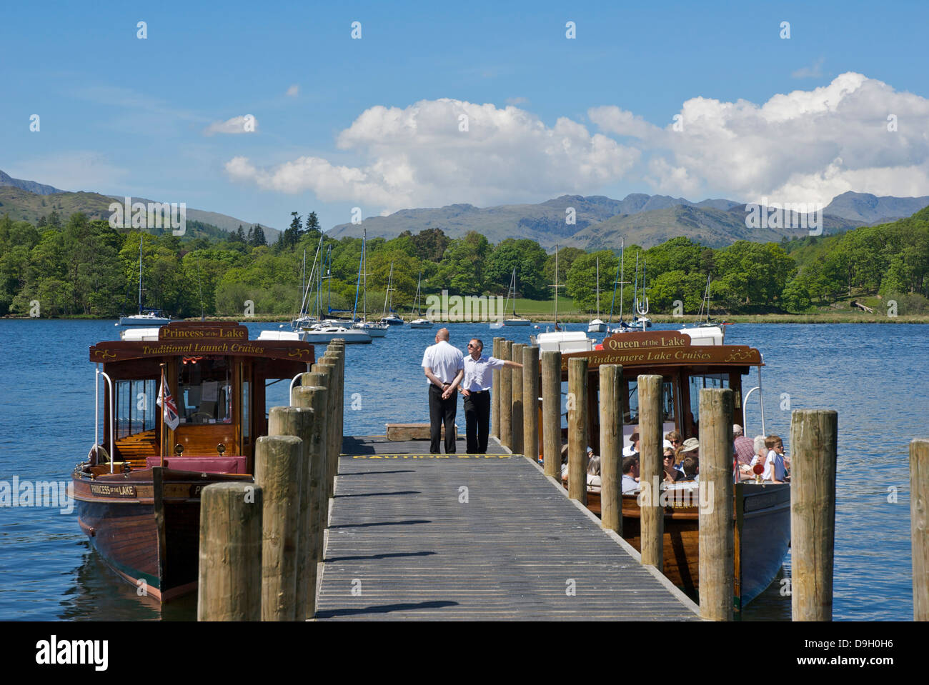 Employees of Windermere Lake Cruises and passenger boats - Stock Image