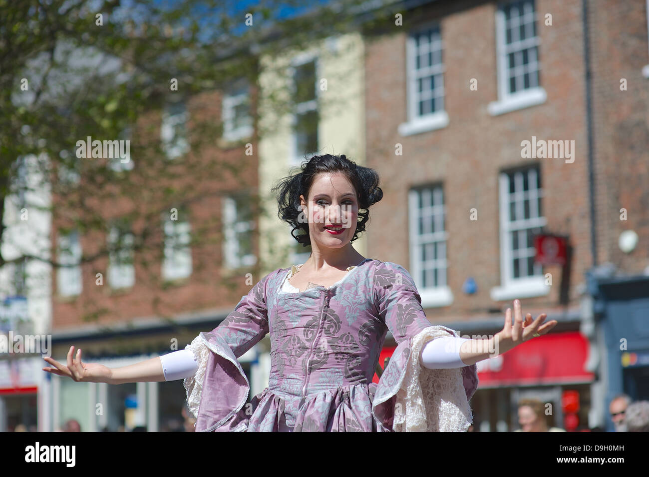 Kate Mior, a Canadian performance artist wows the York crowds with her clockwork dancer act. - Stock Image