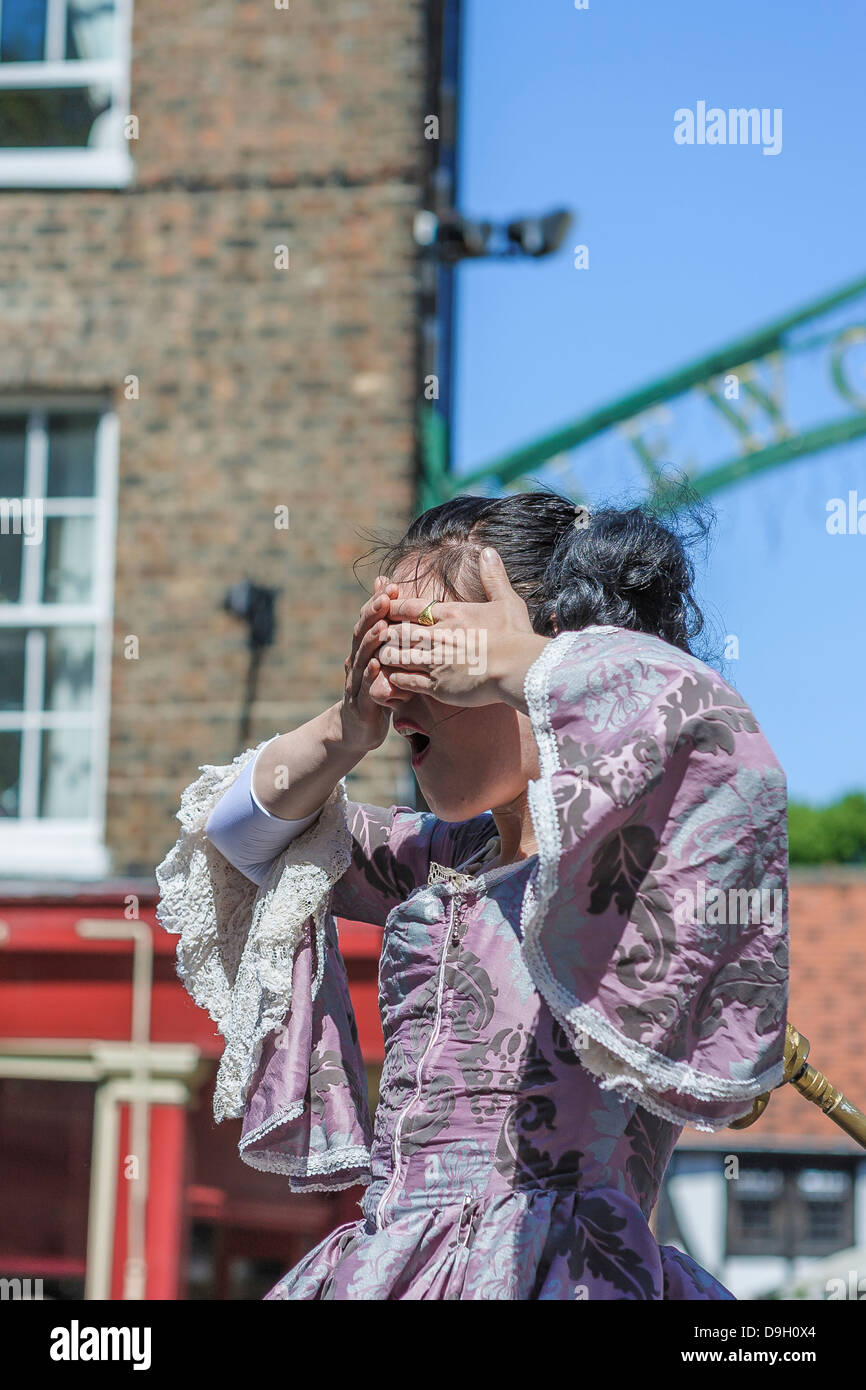 Kate Mior, a Canadian performance artist wows the York crowds with her clockwork dancer act. Here she covers her - Stock Image