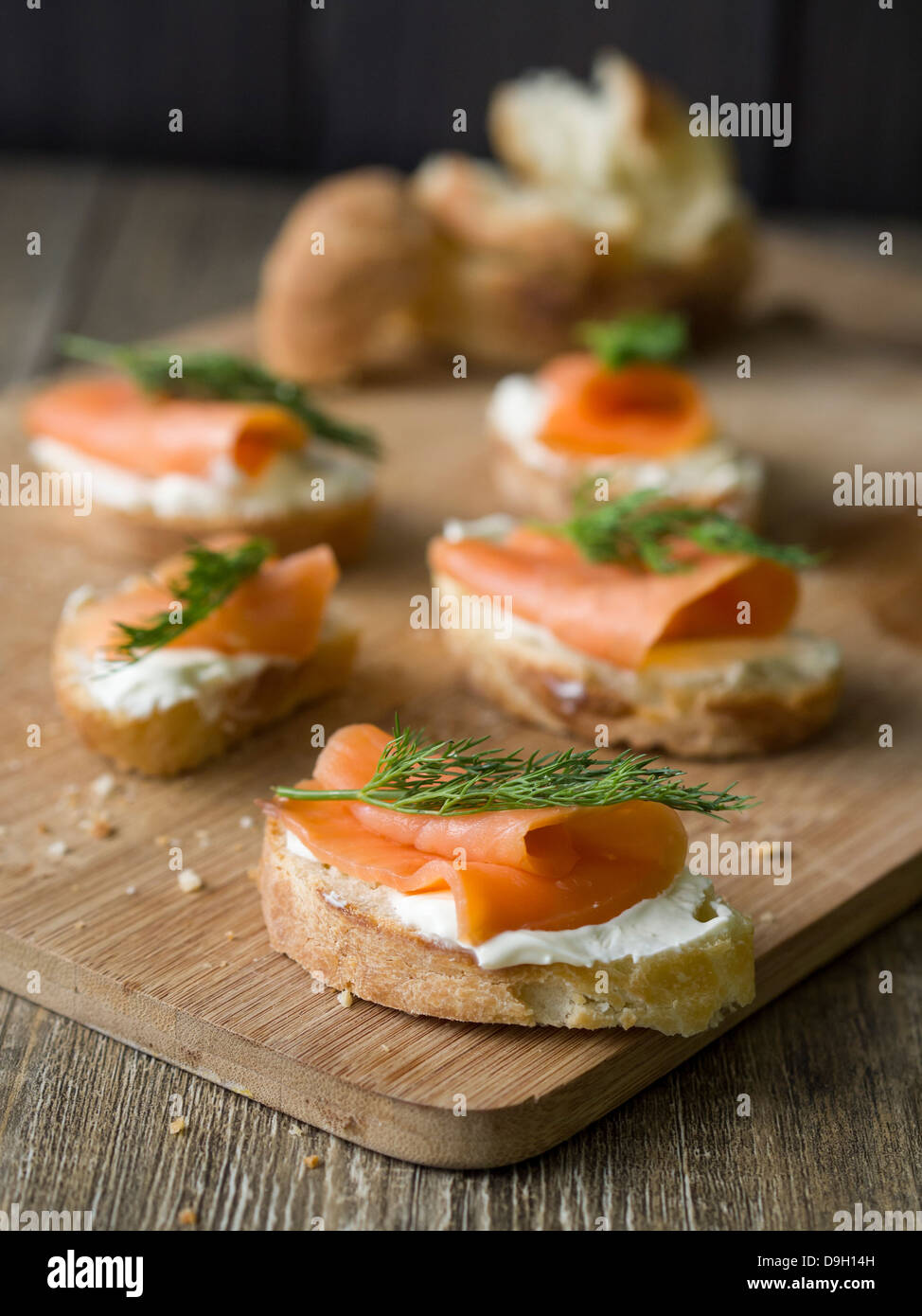 Smoked salmon sandwich on homemade baguette. - Stock Image