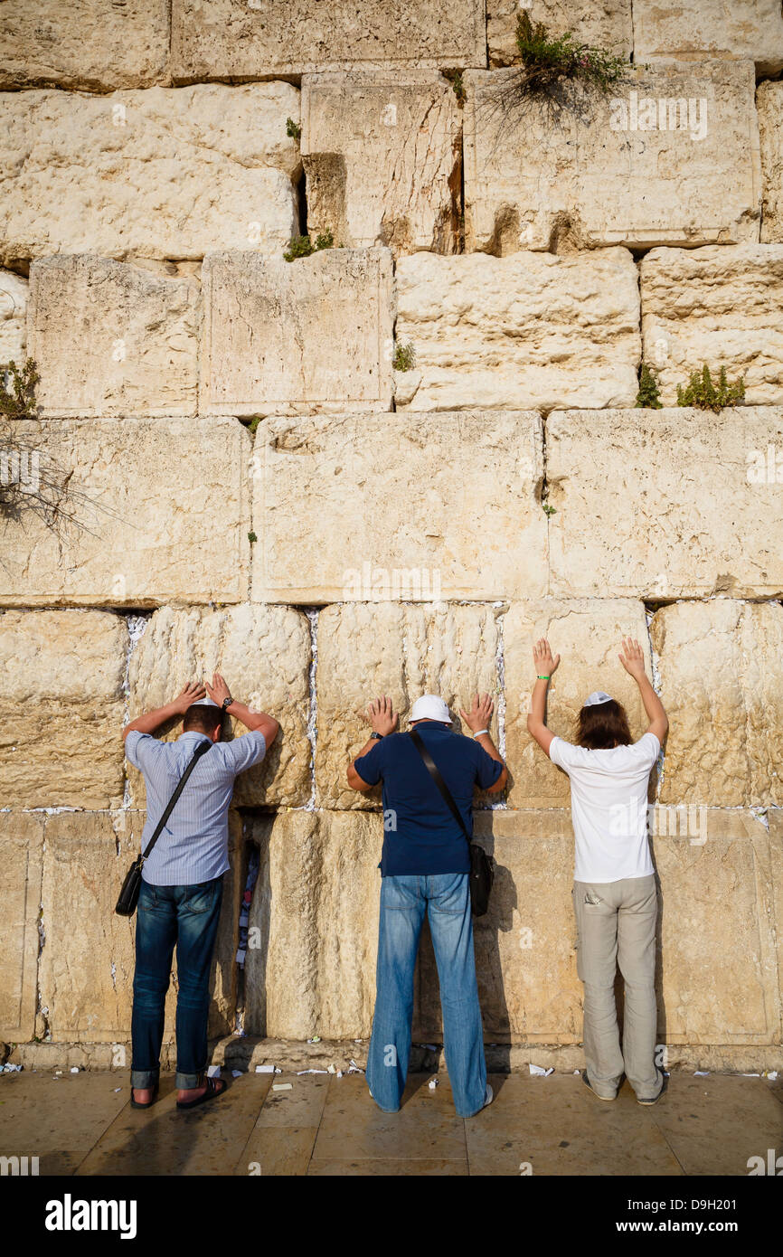 Jewish people praying at the wailing wall known also as the western wall , Jerusalem, Israel. - Stock Image