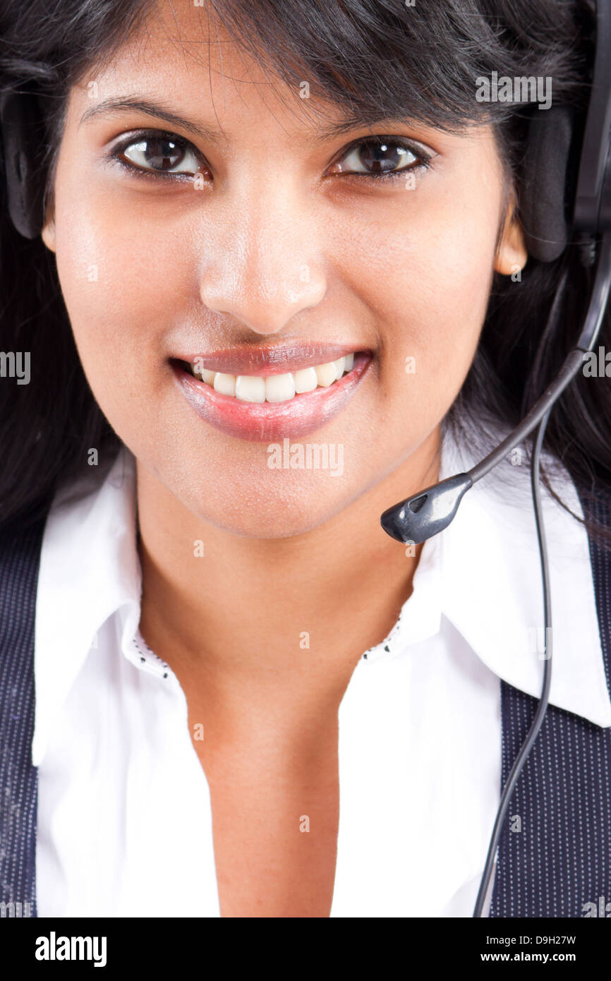 young Indian business woman or telephone operator with headset Stock Photo