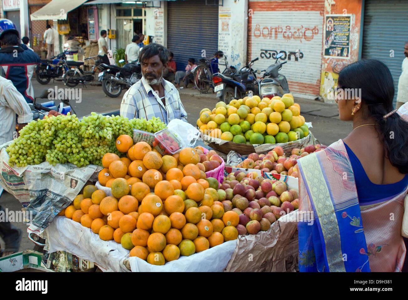 Asia, India, Karnataka, Mysore, fruiterer in his market stall Stock Photo