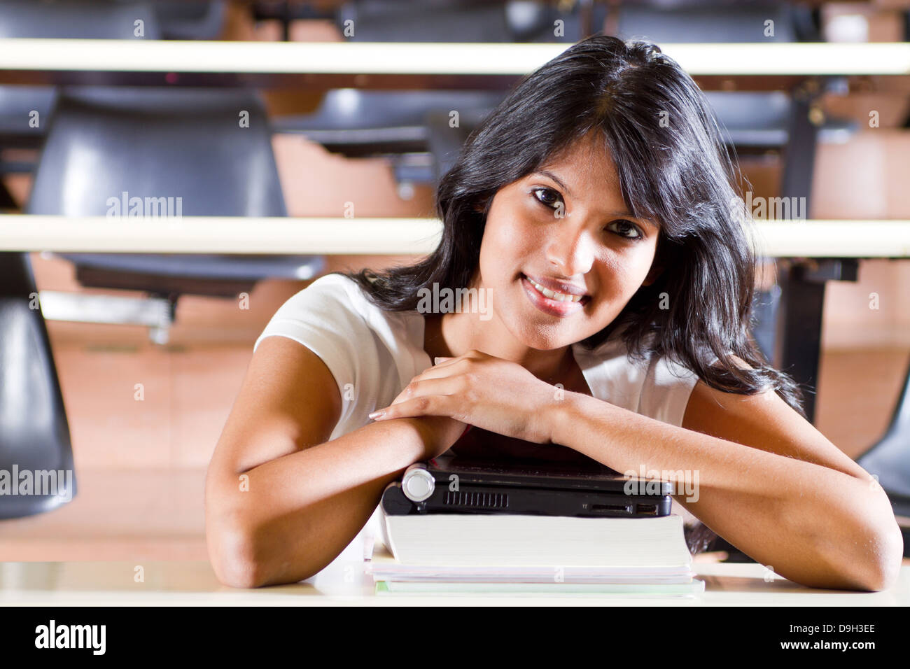 Female college student in university lecture room - Stock Image