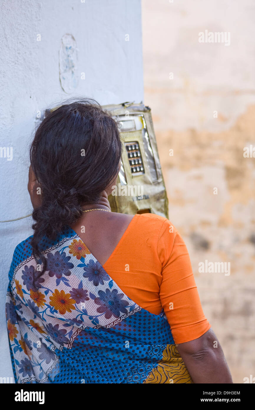 Asia, India, Karnataka, Mysore, Indian woman phoning with a public telephone - Stock Image