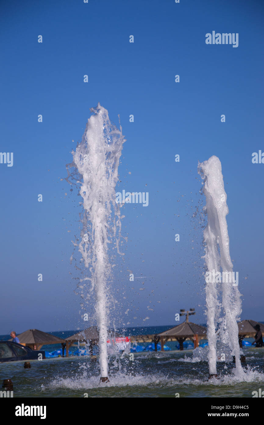 Splashes of fountain water in a fine day - Stock Image